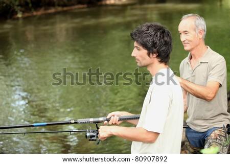 Two men fishing - stock photo