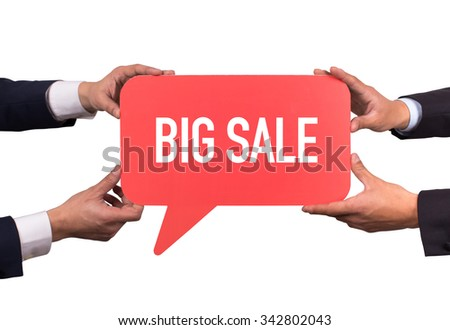 Two men holding red speech bubble with BIG SALE message - stock photo