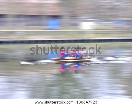 Two men in a row boat with panning and motion blur effect. Zwei Männer in einem Boot, Ruderer in einem Ruderboot mit Bewegungsunschärfe. - stock photo