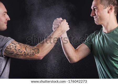 Two men in studio, isolated on black. - stock photo