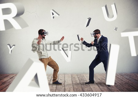 Two men, one in casual clothes, another in dark business suit, are wearing virtual reality glasses and standing in fighting poses ready to start their combat - stock photo