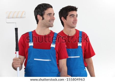 Two men painters on white background - stock photo