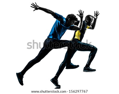 two men racing  running sprinting  in silhouette studio isolated on white background - stock photo