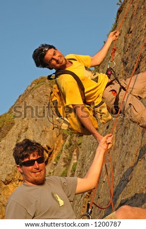 Two Men Rappel off Mountain in Southern California - stock photo