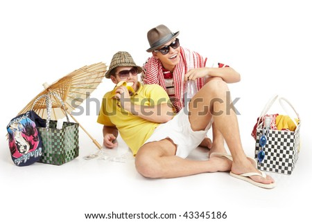 two men sitting in a summer dress and relaxing - stock photo