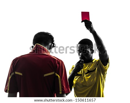 two men soccer player and referee showing red card in silhouette  on white background - stock photo