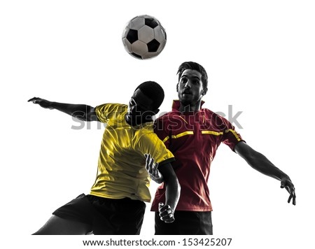 two men soccer player playing football competition fighting for a ball in silhouette on white background - stock photo