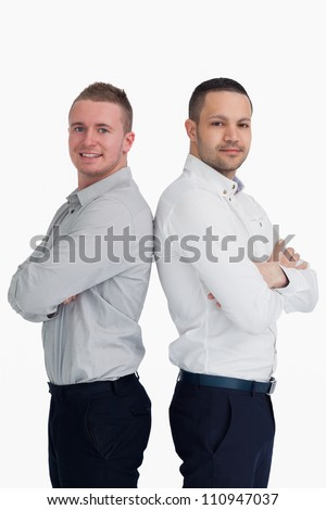 Two men standing back to back against a white background - stock photo