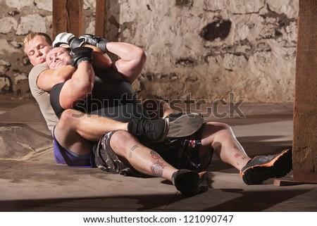 Two men training in rear choke holds - stock photo