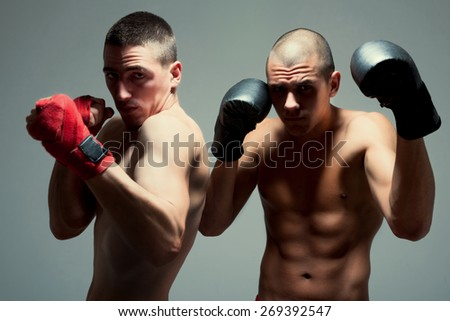 Two men with boxing glove ready for fighting - stock photo