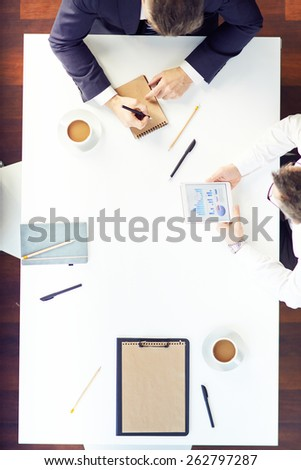 Two men working at office table - stock photo