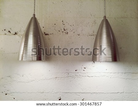 Two metal lamps near white wall. Contemporary design.  - stock photo