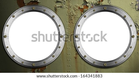 Two Metal Portholes on Green Background / Double metal portholes with bolts on rusty green painted metal background with cracked paint - stock photo