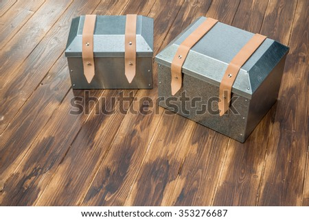 two metal tool box on wooden table, Studio Shot - stock photo