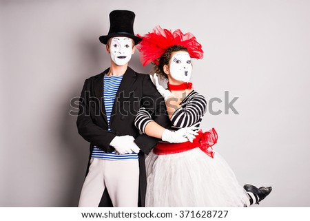 Two mimes man and  woman in april fools day - stock photo