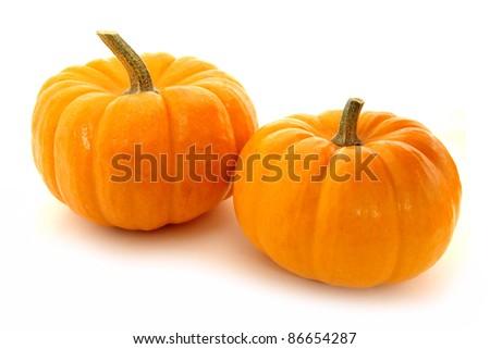 Two mini pumpkins on a white background - stock photo