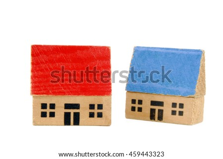 two miniature wooden houses - stock photo
