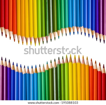 Two mirrored waves of colorful pencils - stock photo