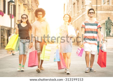 two mixed race couples making shopping in the city center  - stock photo
