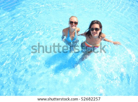 Two models in a pool in Greece - stock photo