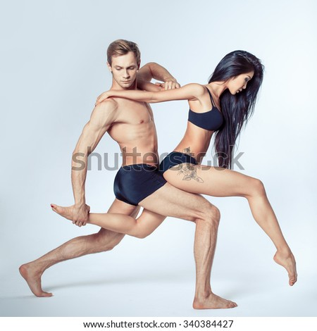 two modern ballet dancers posing on white - stock photo