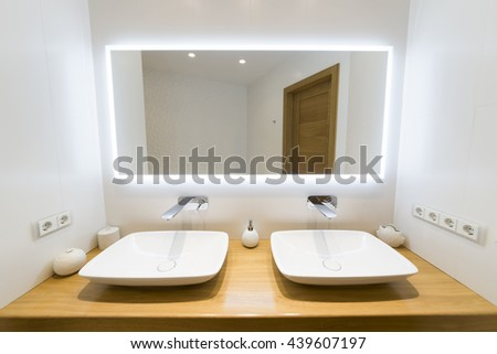Two modern sink in the bathroom, and big mirror with blue mask - stock photo