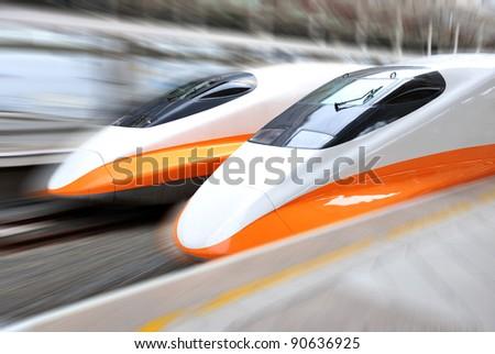 two modern train speeding with motion blur. - stock photo