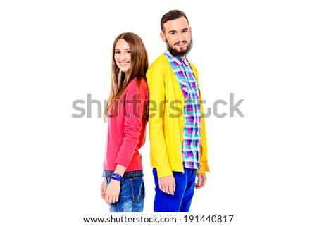 Two modern young people standing together and smiling. Isolated over white. - stock photo