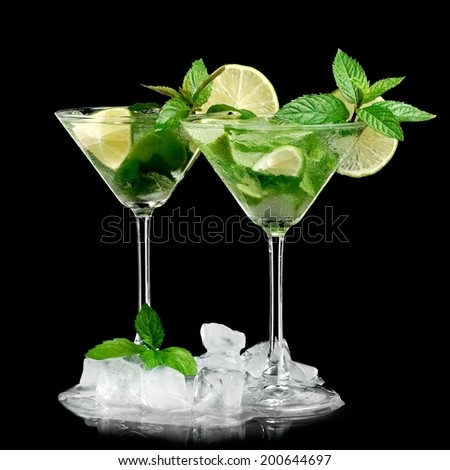 Two mojito cocktails in martini glass - stock photo