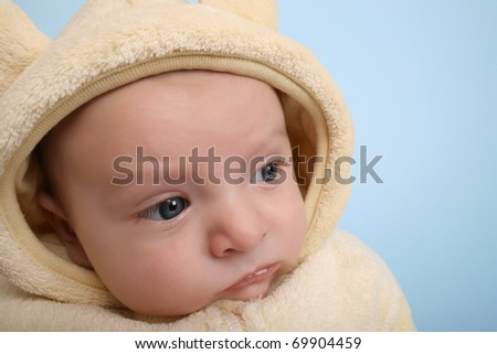 Two month old baby boy wearing a soft animal suit - stock photo