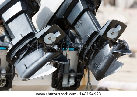 Two motor boat engines with propellers - stock photo