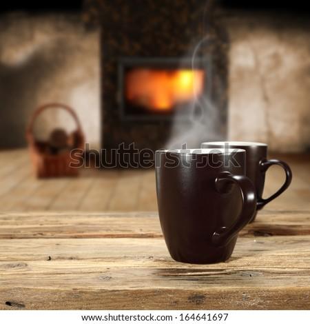 two mugs and fireplace  - stock photo