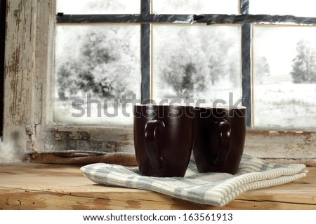 two mugs of winter  - stock photo