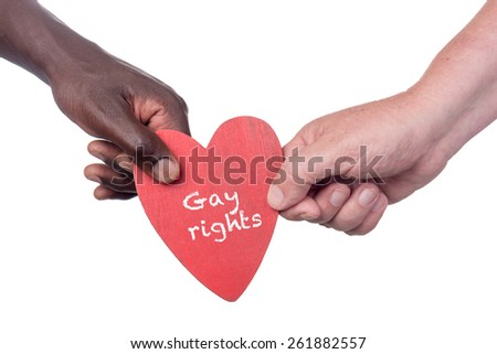 Two multi racial men holding a gay rights wooden heart - stock photo