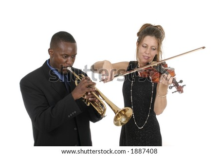 Two musicians tune up before a concert while still having fun with each other. - stock photo