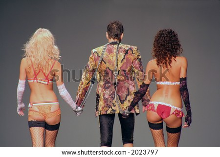 Two naked women and man - stock photo