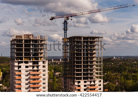 Two new building high-rise buildings against the background of the village - stock photo