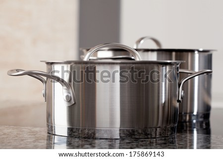Two new clean aluminum pots in the professional restaurant kitchen - stock photo