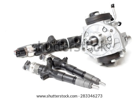 two new injectors for diesel fuel with the fuel pump are high davteniya and fuel strap on a white background - stock photo