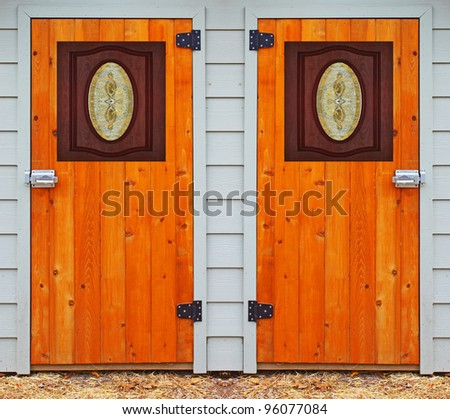 Two newly stained and shellacked doors with a beautiful etched glass windows in them for you to choose from with room for your text - stock photo