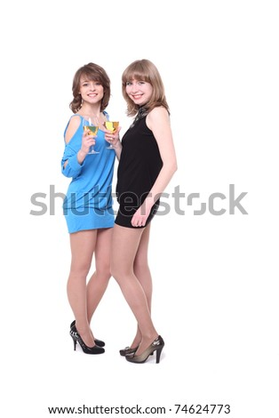 Two nice girls drink wine on a party - stock photo