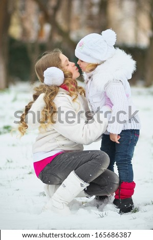 Two of cute happy children walking in winter snow park - stock photo