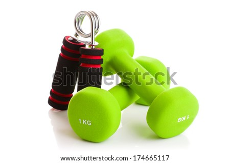 Two of dumbbells with the simulator for hands Isolated on white background - stock photo