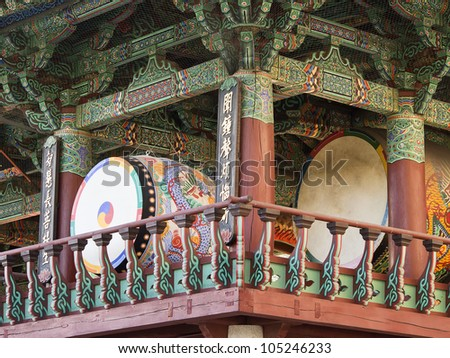 Two of the huge drums at the Bongeunsa Buddhist Temple in Seoul, South Korea. The drums are kept in a building that is painted in bright decorative colors. - stock photo