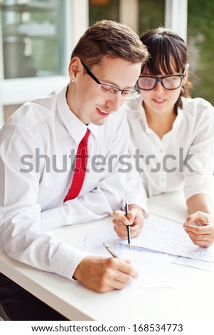 two office workers creating together - stock photo