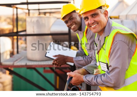two oil and chemical industry technicians in plant - stock photo