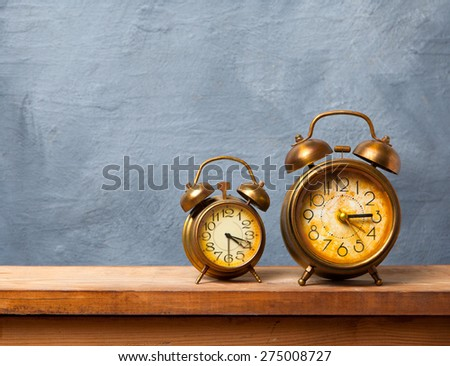 Two old alarm clock on the table - stock photo