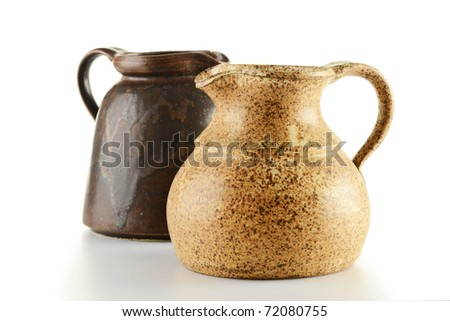Two old jugs isolated on white - stock photo