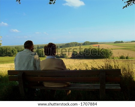Two old people admire the landscape - stock photo