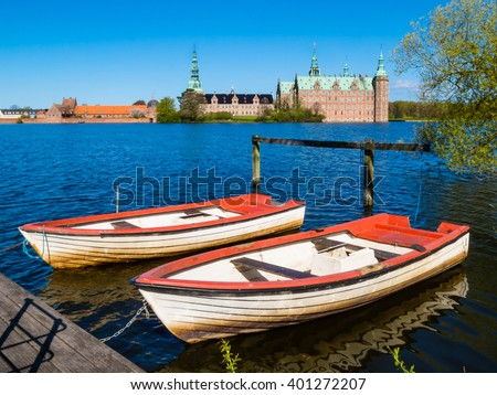 Two old row boats at the mooring on the Castle Lake. Hillerod, Denmark - stock photo